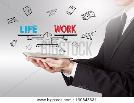 Work Life Balance, young man holding a tablet computer