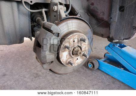 Modern car take wheel off show brake disk and caliper assembly