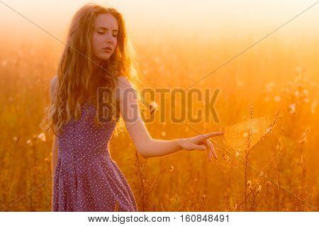 Beautiful Girl In Fog Touching Spiderweb