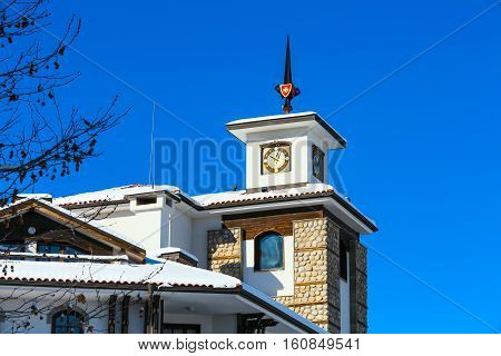 close up chalet with tower against blue sky in bulgarian ski resort Bansko, Bulgaria