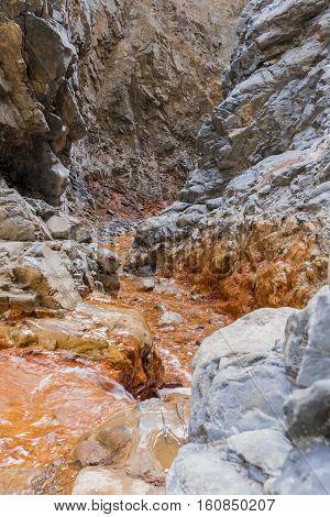 """""""Cascada de los Colores"""" river with its golden color in Caldera de Taburiente national park."""