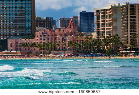 Waikiki Beach Oahu Hawaii USA - September 5 2015: World famouns Waikiki Beach is home to many luxury resort hotels including the 'Pink Palace of the Pacific'- the Royal Hawaiian Hotel established in 1925.