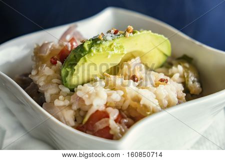 Risotto with prawns and avocado decoration served in a restaurant of La Palma canarian islands.