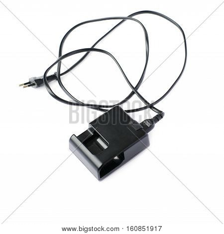 Black battery charger isolated over white background