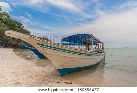 Traditional wooden boat at the beach of Langkawi island Malaysia
