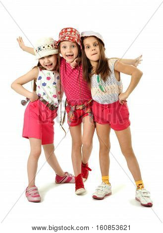 Portrait of three cute expressive girl isolated on white