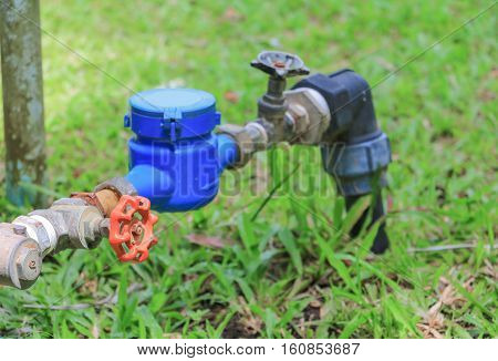 water valve and tap pipe on floor grass with copy space for add text