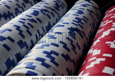 A low angle image of poker chips in a row.