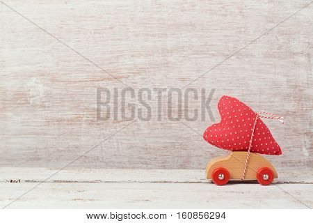 Valentine's day concept with toy car and heart shape