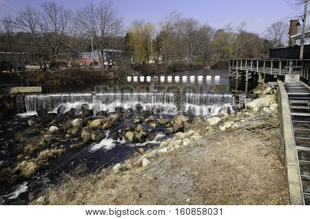 South County Bike Trail overlooking spillway on Saugatucket River in Wakefield Rhode Island
