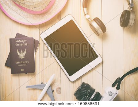 Hi tech traveler Gadgets traveling stuff with blank tablet screen.