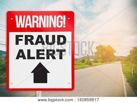 Fraud Alert ahead warning signage on the road ahead.