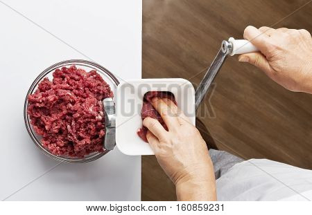 Cooking ground beef in a meat grinder