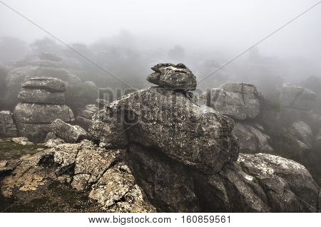 El Torcal De Antequera in the fog Malaga Spain. Unusual stunning rock formation
