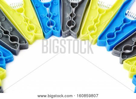 Semicirle shape of plastic cloth pegs isolated over white background