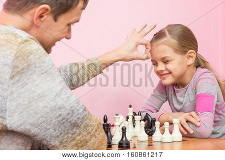 Dad Won A Game Of Chess At A Daughter On A Bet And Hit Her On The Head