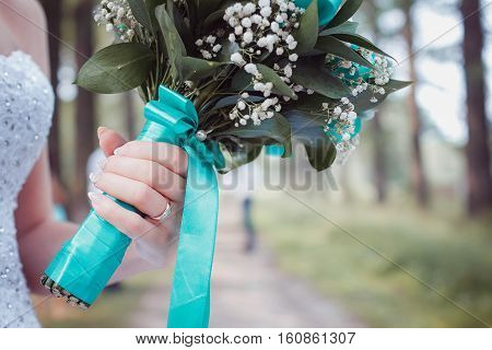 the bride holding a bouquet in one hand