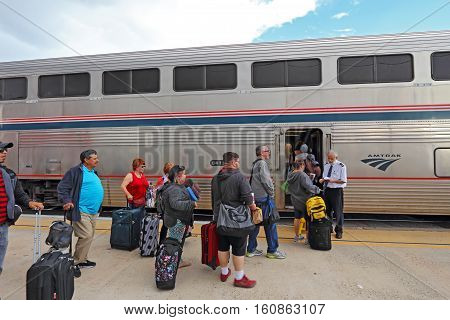 ALBUQUERQUE NEW MEXICO - OCTOBER 9 2016: Passengers wait to present their tickets for boarding the Southwest Chief Amtrak train to Los Angeles California at the station in Albuquerque New Mexico.
