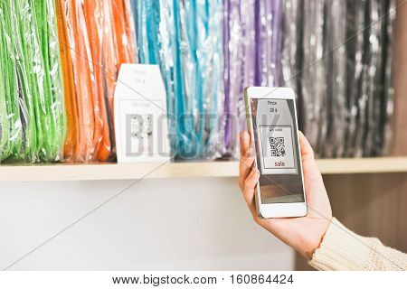Hand scanning qr code with smartphone on showcase sale advertising shopping modern technology concept