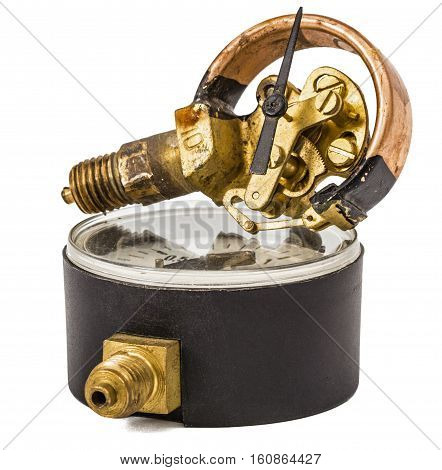 Pressure gauge mechanism in disassembled form instrument for the measurement of pressure and vacuum isolated on white background