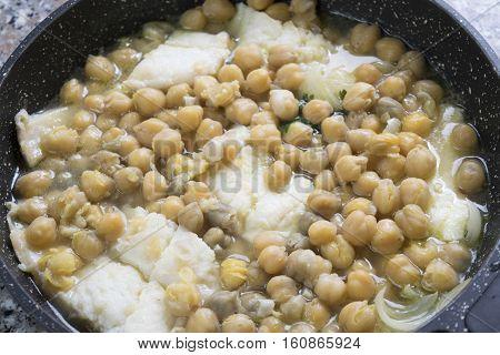 soup of salted codfish with chickpeas in pan