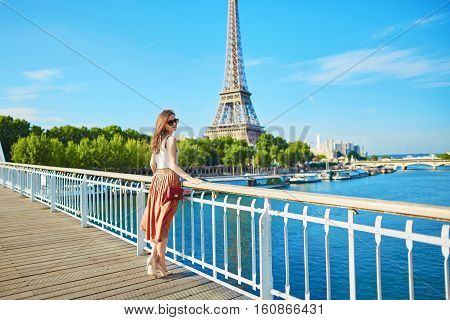 Beautiful Young Parisian Woman Near The Eiffel Tower