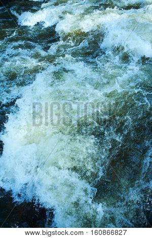 Fast flowing river, fresh water closeup in motion