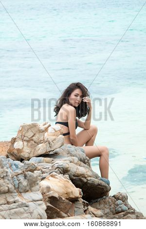 Happy Woman Enjoying Beach Relaxing Joyful In Summer By Tropical Blue Water. Beautiful Bikini Model