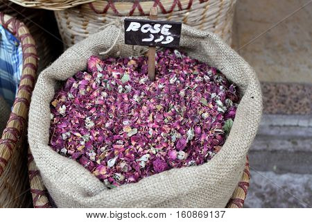 A sack of dried pink rose petals at an old Lebanese souk.