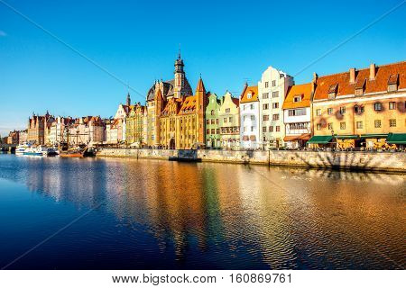 Morning view on the riverside of Motlawa river with beautiful buildings of the old town in Gdansk, Poland