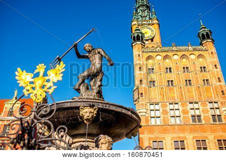View on the town hall and famous Neptune fountain in the center of the old town of Gdansk, Poland
