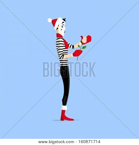 A Mime performing a pantomime called keeping a flower warm