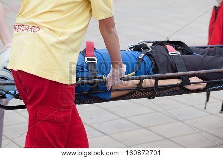 Paramedics evacuate an injured person. First aid training.