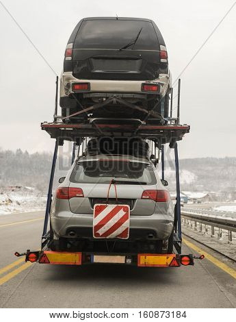 Towing truck transports used cars from European Union