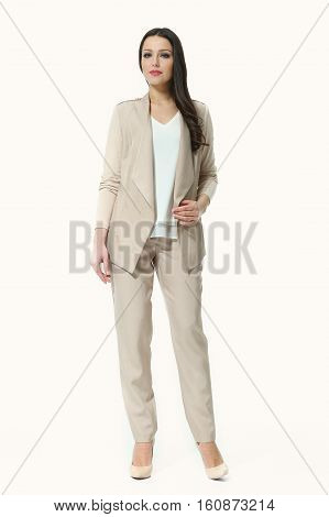 woman with straight hair style in casual white jacket black trousers full body photo high-heeled shoes isolated on white