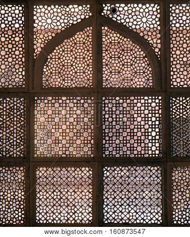 FATEHPUR SIKRI, INDIA - FEBRUARY 15 : Intricate window artwork in the tomb of Salim Chishti at Fatehpur Sikri complex, Uttar Pradesh, India on February 15, 2016.