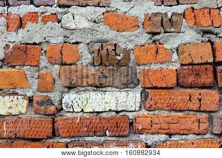 Texture of very ancient brick wall close-up background