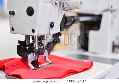 sewing machine. Equipment garment factory. The concept of the textile industry.