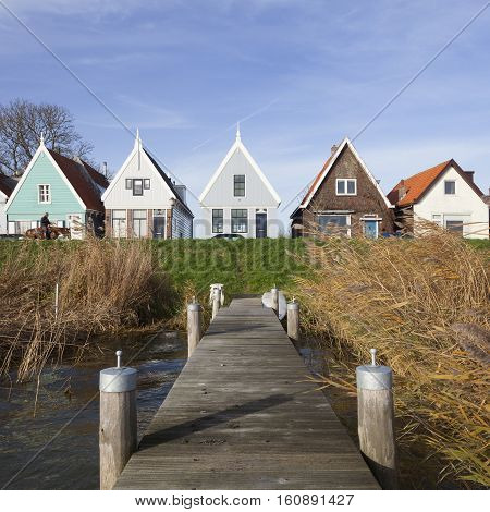 Durgerdam, Netherlands, 22 november 2016: jetty and old wooden houses on the dike of durgerdam near amsterdam in the netherlands