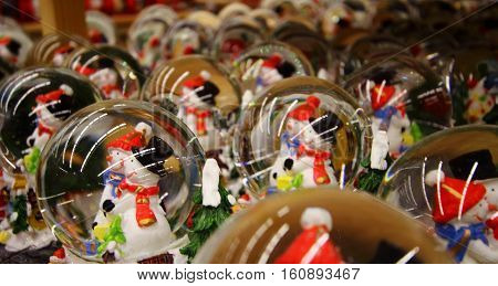 New Year Decor Shop. Funny snowmans in snowball stock photo
