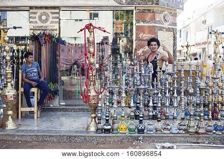 Egypt Sharm el sheikh - august 2016: hookah shop bazaar sell with friendly dealer, friendliness gestures