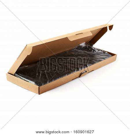 Black computer qwerty keyboard packed into cardboard box isolated over white background