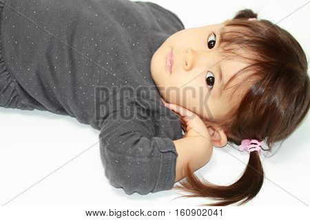 Lying cute Japanese girl (2 years old)