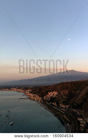 Mount Etna And The Giardini Naxos Coastline At Dawn
