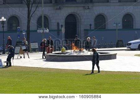 Ottawa, Canada. November 14Th 2016 - People Relaxing On A Sunny Day At The Parliament Of Canada On P