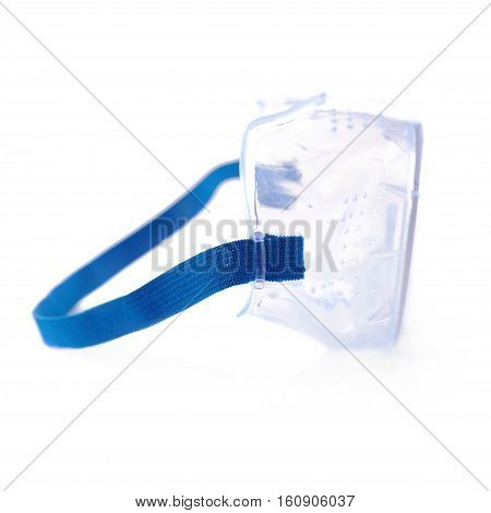 Blue plastic protective work glasses with ruber band isolated over white background.