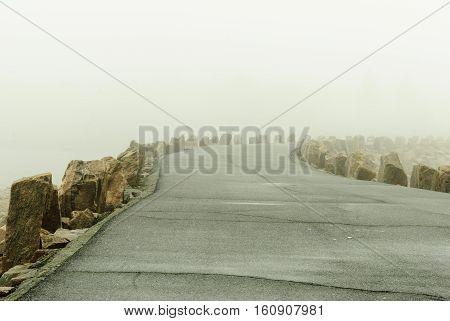 Winter fog shrouds hurricane barrier access road