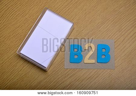 Top View Flat Lay Blank Stack Of Business Cards In Its Case With Word B2B For Business To Business M