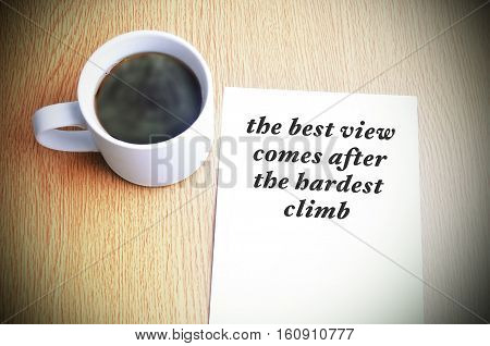Inspirational Motivating Quote On Paper With Black Coffee On The Table