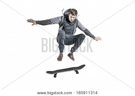 jumping skateboarder isolated against the white background